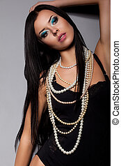Passionate Young Female Body in Black Lingerie with Beads