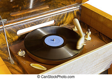 Vintage gramophone is playing a record