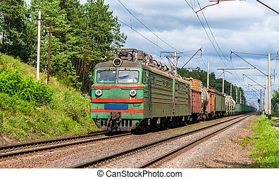 Freight train hauled by old electric locomotive. Ukraine