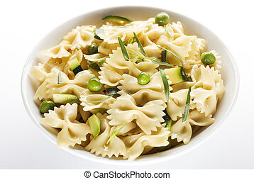 pasta - fresh pasta with peas and pumpkin isolated on white