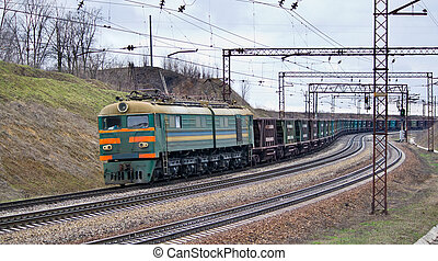 Train with iron ore pulled by electric locomotive