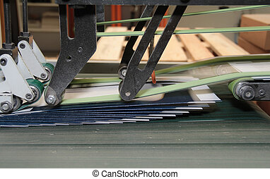 folding machine detail - detail of a folding machine with...