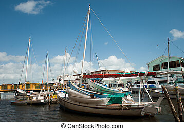 Row of white yachts in the port, Belize City