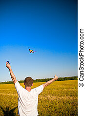 launching a kite - young man flies a kite