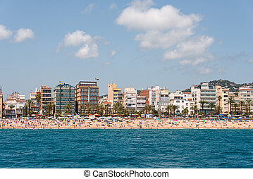 City beach of Lloret de Mar Costa Brava - People swim and...