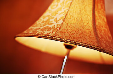 Floor lamp with shadow in hotel room