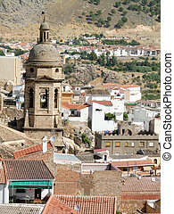 Spanish church tower and roofs in Loja