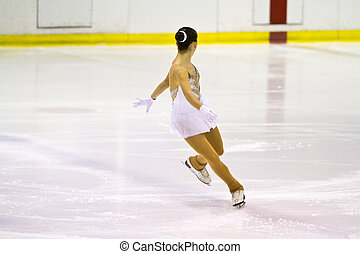 woman figure skater performing  on ice