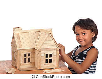 This is my house - A smiling young girl stands next to the...