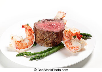 Surf and turf side view - Giant prawns with tenderloin steak...