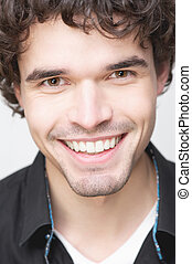 Handsome Man with Toothy Smile - Close up portrait of a...
