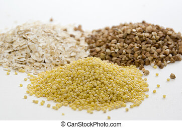 Cereal of oat, buckwheat and millet - Three piles of cereal...