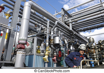 oil industry and engineering - engineer working inside large...
