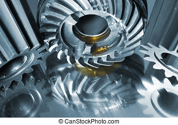 gears and cogwheels in steel - gears and cogs against blue...
