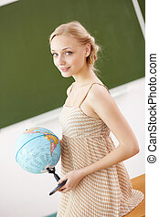 Teacher at school with a globe