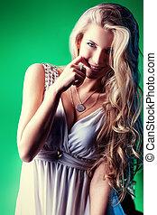 flirting girl - Charming blonde woman in light white dress...