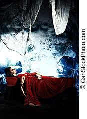 sleeping vampire - Bloodthirsty vampire woman lies in a...