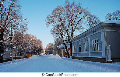 Snow covered street in a small town