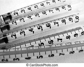 syringes - closeup of syringe needles on white background