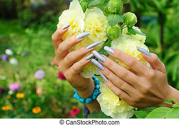 Manicure on real nails and yellow hollyhock flower - Silver...
