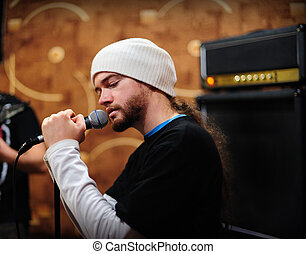 Frontman singer - Man singing on a rehearsal