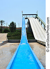 Waterpark slides - Steep blue and white slides in a...