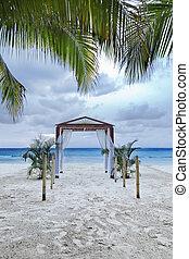 Tropical Wedding - A beach wedding archway on a tropical...