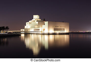 Museum of Islamic Art in Doha illuminated at night Qatar,...