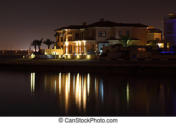 Waterside buildings at night. The Pearl in Doha, Qatar