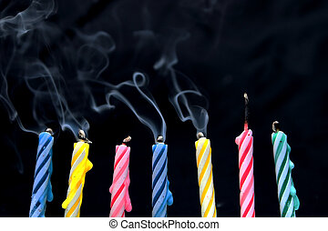 Birthday Candles - Several wax candles typically used for...