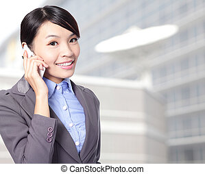 woman happy talking mobile phone - close up of Beautiful...