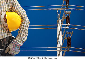 high voltage electricity pole in blue sky - high voltage...