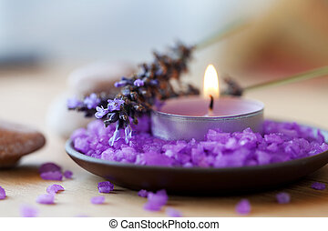 Candle in a saucer with salt baths and sprigs of lavender -...