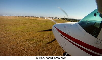 Private airplane landing. View from an aircraft wing.