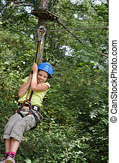 Preteen girl zipping down - Preteen girl is zipping down at...