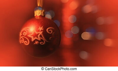 Christmas ball rotates at the background of blurred night...