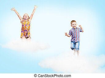 girl and boy on clouds and a rainbow - girl and boy jumping...