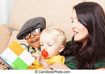 Family reading book - Young happy woman with children...