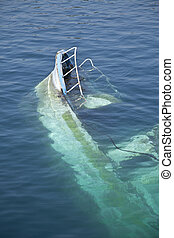 wreck of a boat that emerges from the water