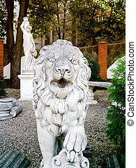 Stone lion roaring - Roaring stone lion stands in the...