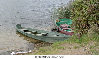 old wooden sunken boats - retro old wooden row boats sunken...