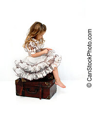 Beauty Pagent Girl - Gorgeous little girl sits on a stack of...