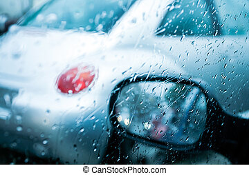 Driving in a rain and traffic jam