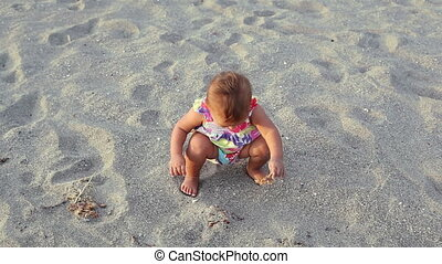 Small girl - Adorable small girl walking at beach