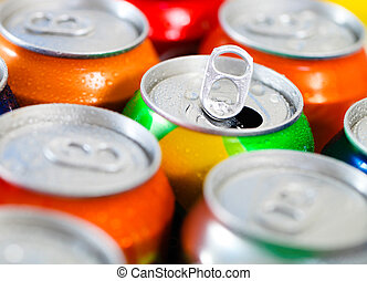 Cans of sweet drinks (or beer). Cooling frozen and with...