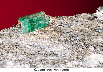 Rare emerald raw precious gemstone on matrix rock, an...