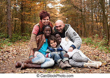 Multicultural family - Happy family with foster children in...