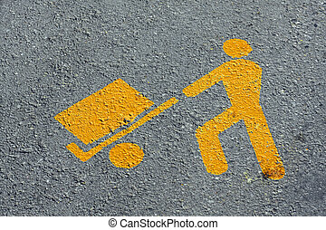 yellow man who load merchandise transport in asphalt -...