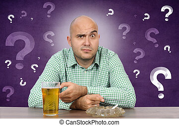 Beer and cigarette - Man hesitating whether with cigarette...