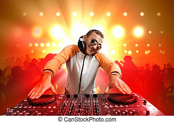 dj and mixer - DJ with a mixer equipment to control sound...